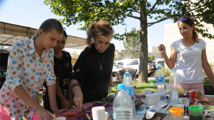 Tatyana (center) conducting an artistic enrichment activity in Uzbekistan