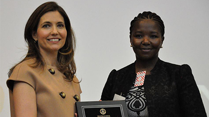 Assistant Secretary Ryan (left) presents the Fall 2013 Alumni Impact Award certificate to Betty Mokoena (right) of South Africa.