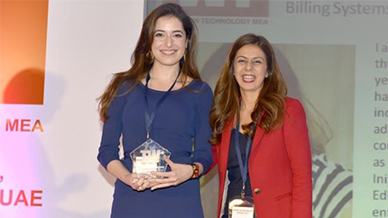 Shaden Mar?i of Jordan (left) receives her award for Best Mid-Level Technology Executive at the Women in Technology Awards in Dubai on January 15th.