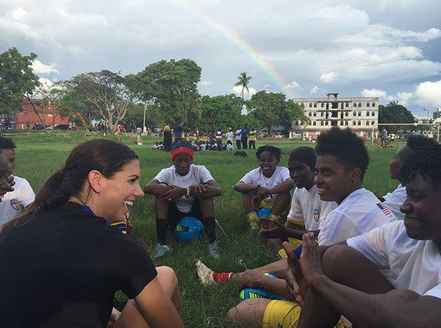 Sports Envoy Alex Morgan talking with youth soccer players in Tanzania.