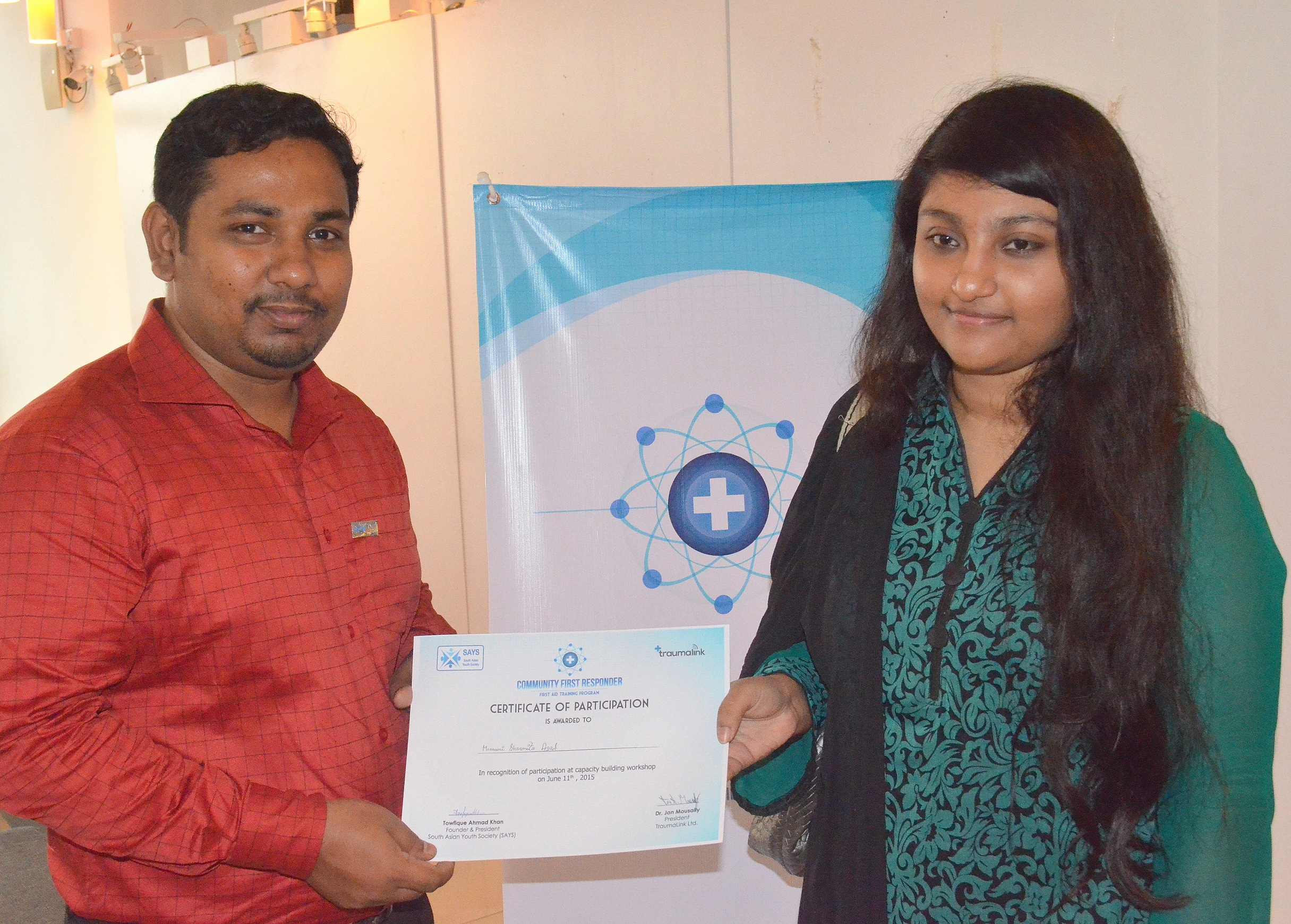 Young man holding and passing certificate to young lady