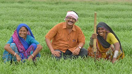 "Biplab Ketan Paul (center) poses with farmers he helped through his innovative ""Bhungroo"" farming method."