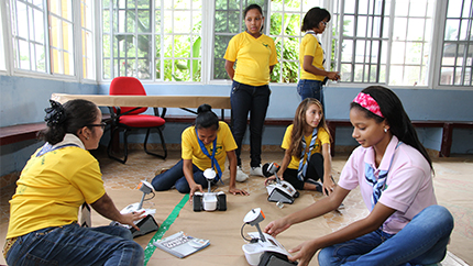 """Panamanian girls work on a project during their """"Wonderful Information and Communications Technology (ICT) Girls Can Do It"""" program."""