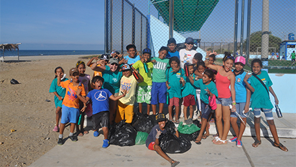 "The ""Sowing Awareness"" AEIF project group teams up with kids to clean up trash on the local beach."
