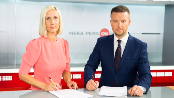 Woman sits next man at TV show news desk