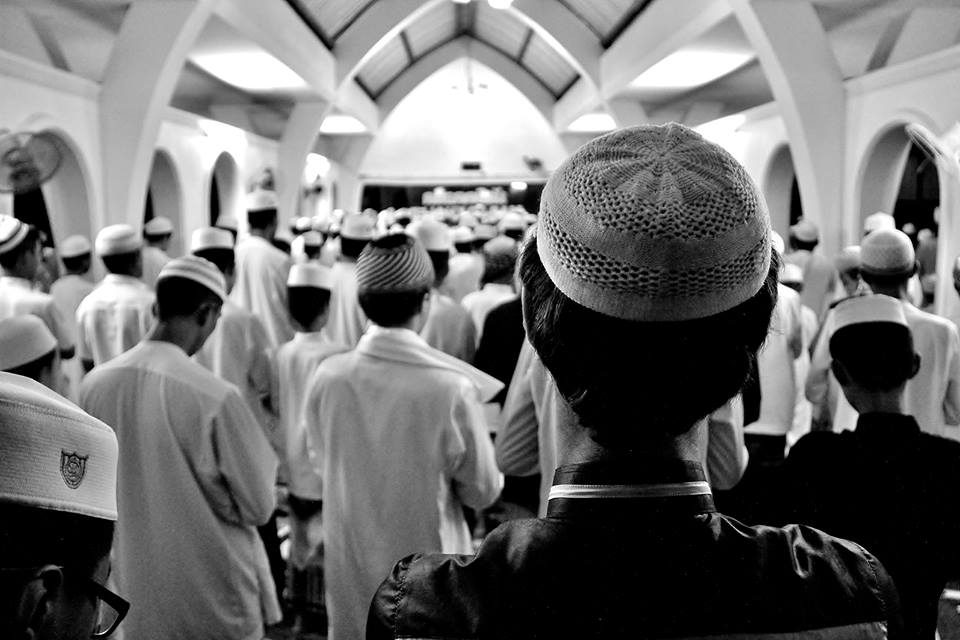 This image captures the fourth of five daily prayers at a southern Thailand Muslim boarding school.