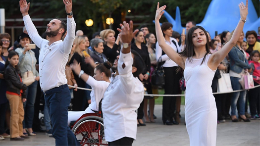 Close up shot of graceful dancers in Armenia wearing white