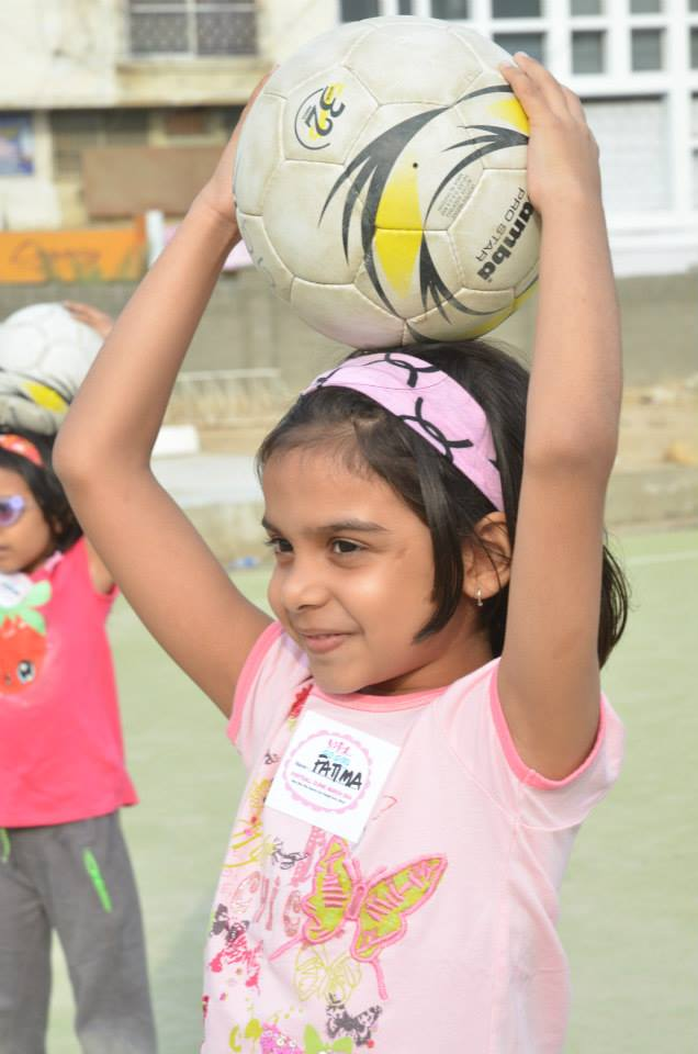 Another young soccer player awaits instruction during a clinic