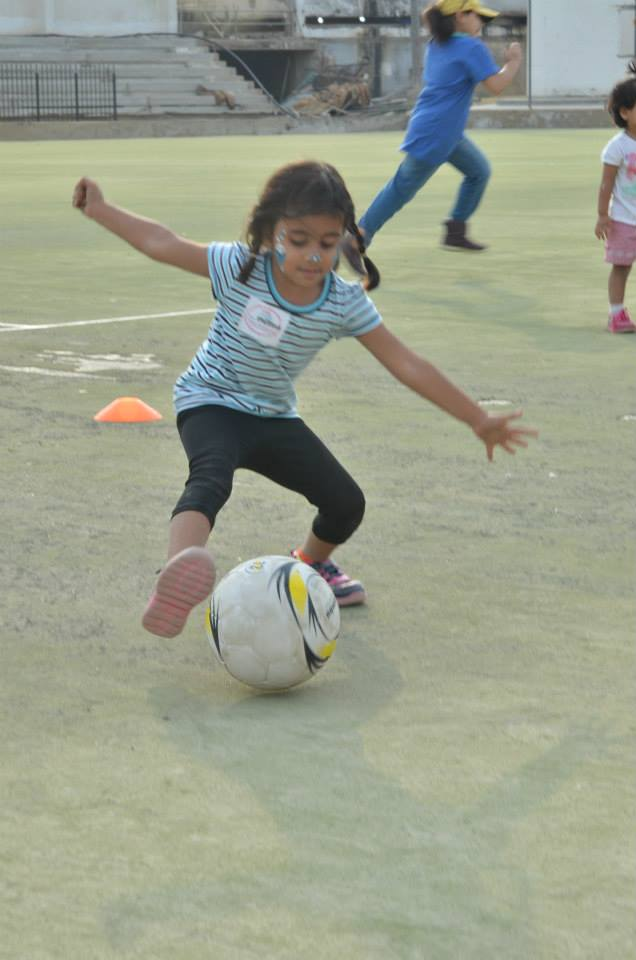A young player practices her ball handling skills during a GO GIRL clinic