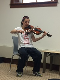 Amy Tran playing a violin