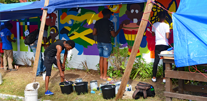 Participants working on standpipe mural