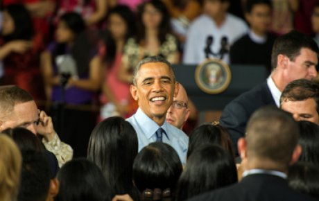 President Obama in the midst of a crowd of people.