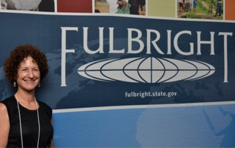 Betsey poses in front of the Fulbright sign.
