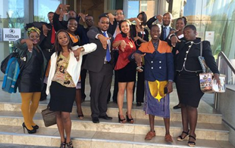 MWF alumni and their Mentees at the Namibia Connect Camp for the Young African Leaders Initiative, showing hands in the shape of Namibia.