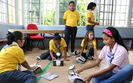 "Panamanian girls work on a project during their ""Wonderful Information and Communications Technology (ICT) Girls Can Do It"" program."
