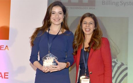 Shaden Mar'i of Jordan (left) receives her award for Best Mid-Level Technology Executive at the Women in Technology Awards in Dubai on January 15th.