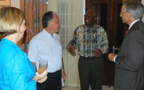 Surinamese Alumni gather with Ambassador Anania, right, and former President Venetiaan, gesturing in middle