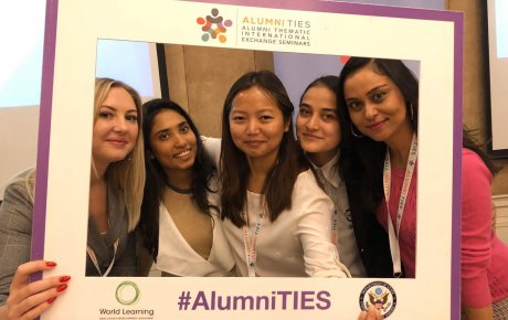 Five alumni at Alumni TIES in Almaty, Kazakhstan