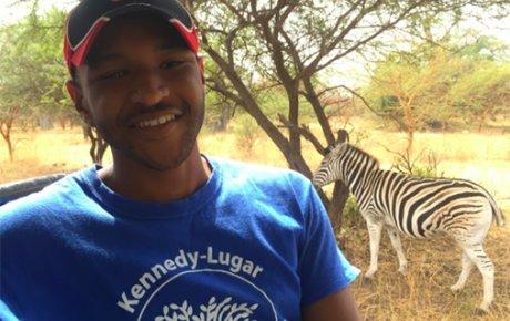 Jason Carroll and a zebra
