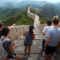 Young adults standing on Great Wall of China