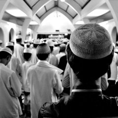 Men praying at a southern Thailand Muslim boarding school