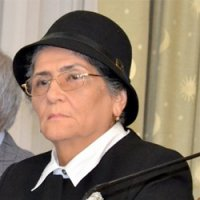 Older woman in black hat with glasses