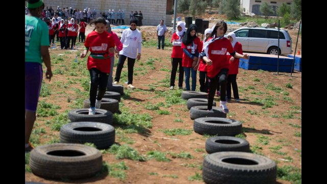 The participants are so enthused for the drills,  that they readily take on the tires to help prepare
